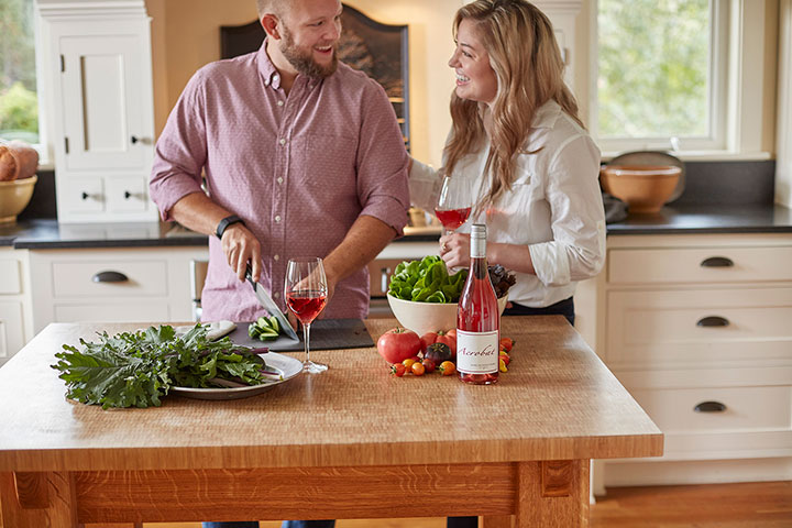 Man and Woman Cooking with Acrobat Rose Wine