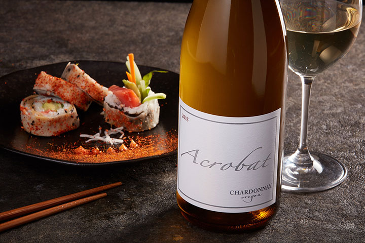 Glass and Bottle of Acrobat Chardonnay With Sushi