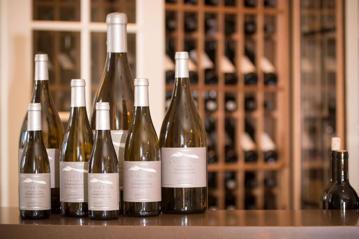 Lineup of various Chalk Hill wines on wooden counter top