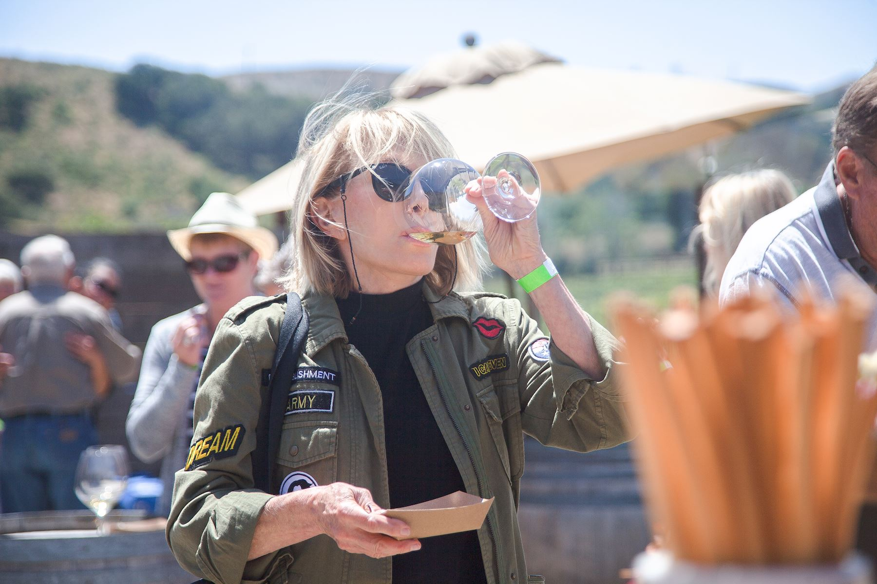 Event attendee enjoying Foley Estate Chardonnay
