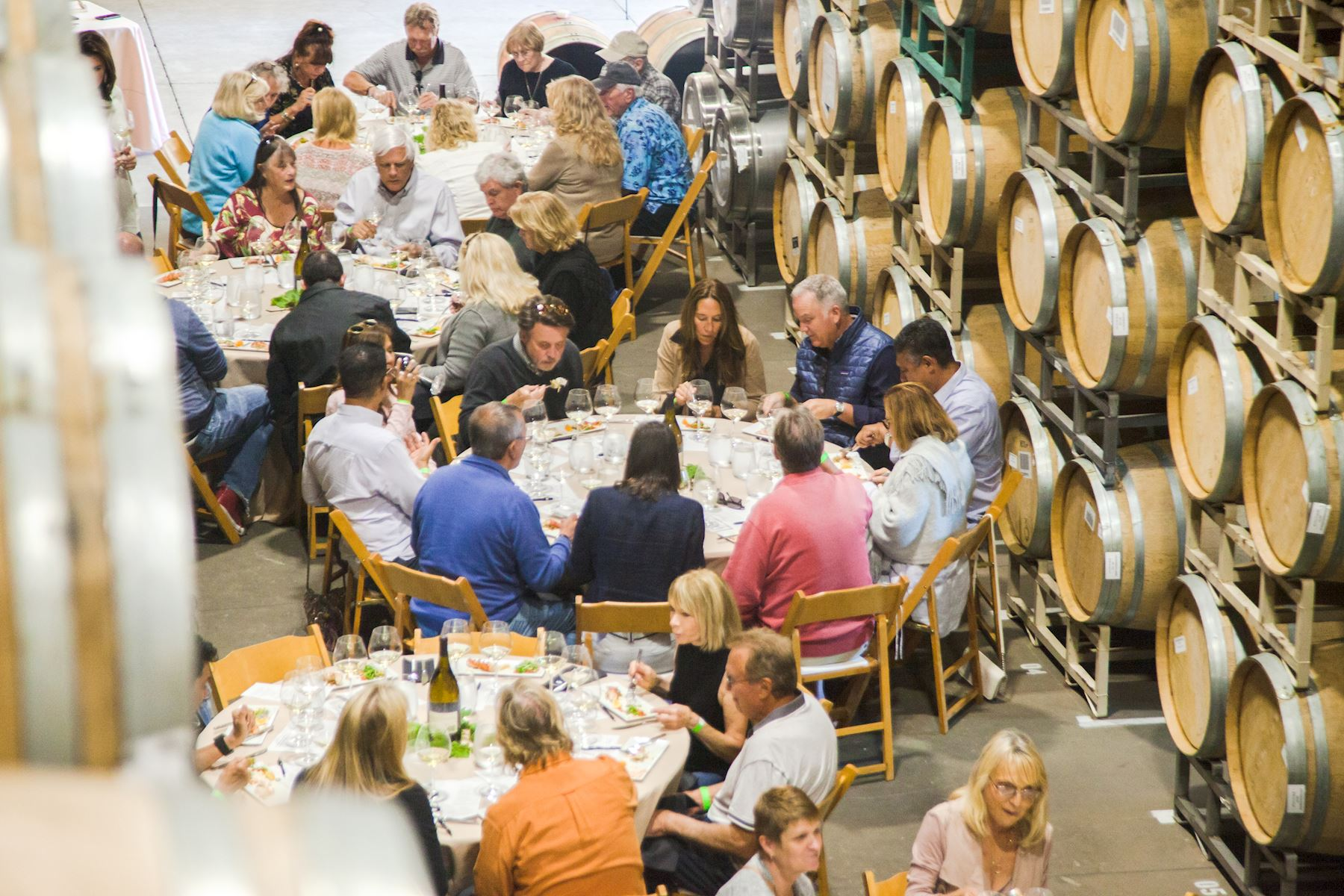 Event attendees socializing over food and wine