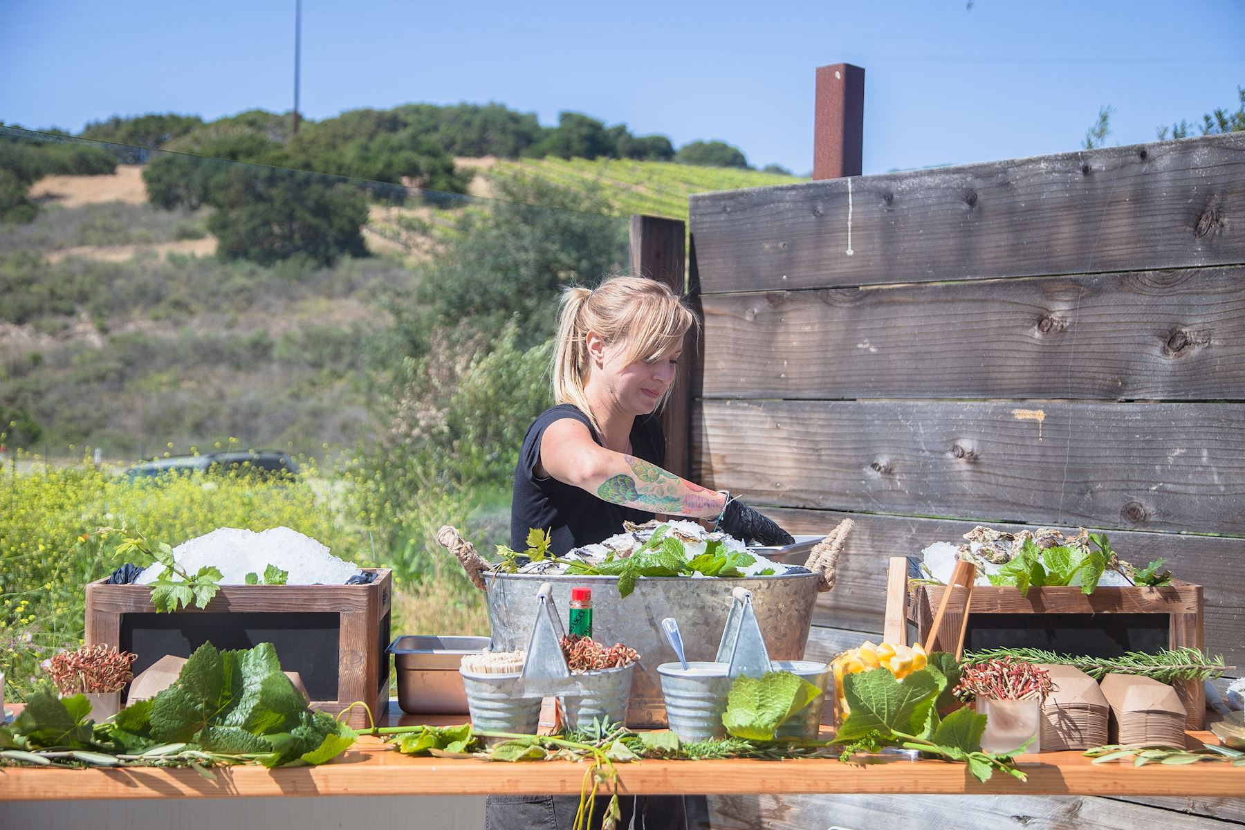 Chef Danelle Jarzynski preparing food for the event