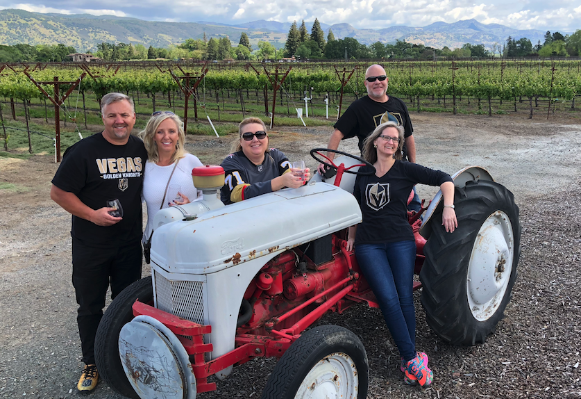Group of People With Vegas Golden Knight T-Shirt Around a Tractor in the Vineyard