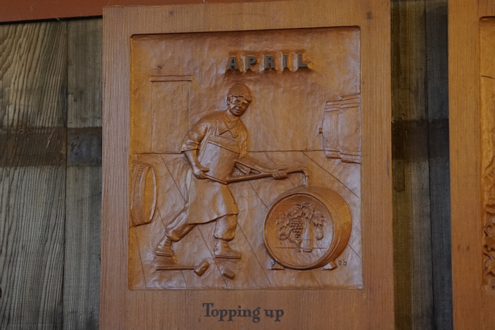 Exquisitely hand-carved wood tile for the Month of April titled Topping Up