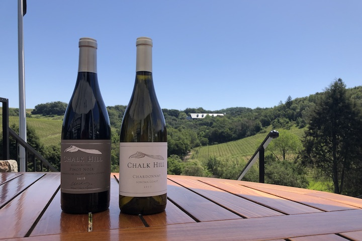 Two Bottles of Chalk Hill Wine on Teak Table