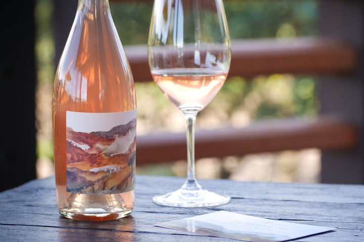 A Bottle of Foley Sonoma Winemaker Series Rose with wine glass on outdoor table