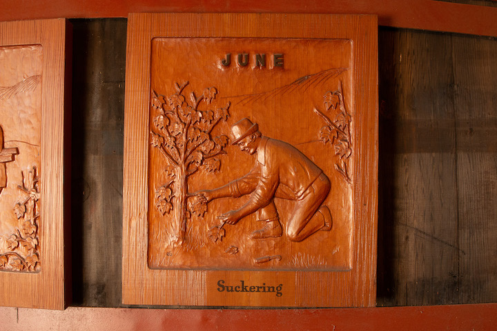 Hand-Carved wood tile labeled