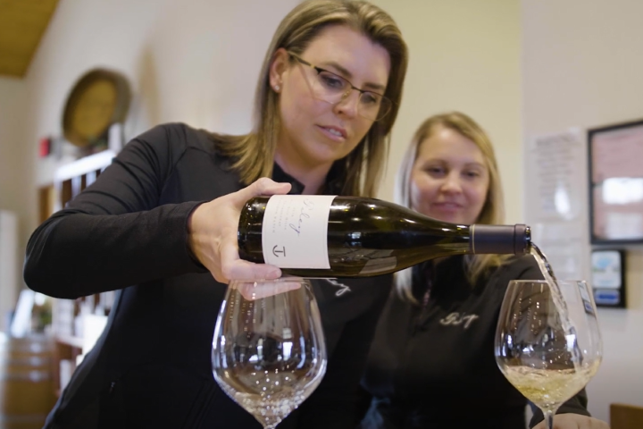 Lindsey Jessup Pouring Foley Estates Wine