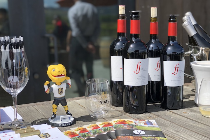Bottles of Red and White wine by Foley Johnson with VGK memorabilia