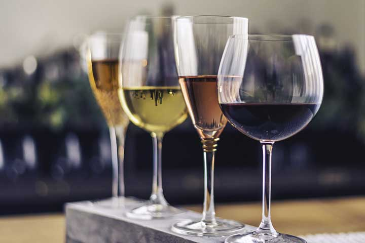 wineglasses lined up on table