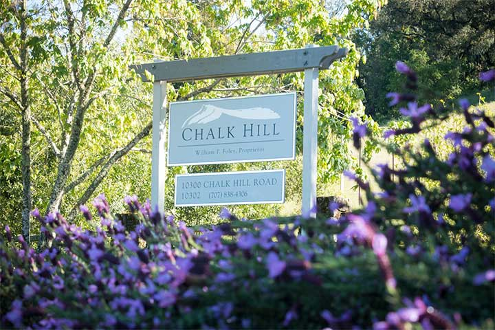 White Chalk HIll Winery Sign Surrounded by Purple Flowers