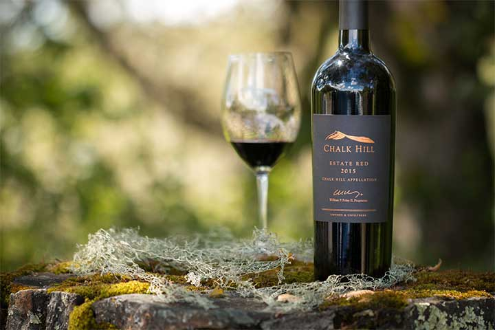Bottle of Chalk Hill Red Wine with Wine Glass