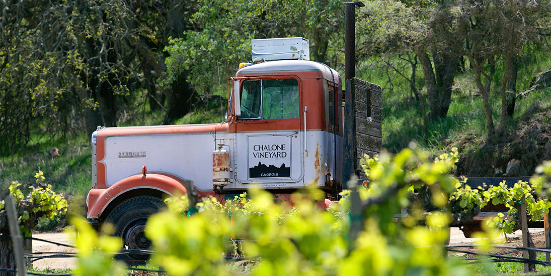 Old Delivery Truck in Field with Chalone Logo on Door