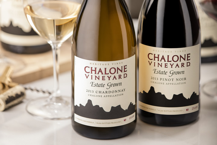 Two Bottles of Chalone Wine Arranged on a Table