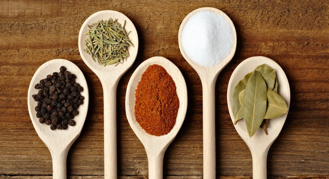 Wooden Spoonfuls of Various Spices