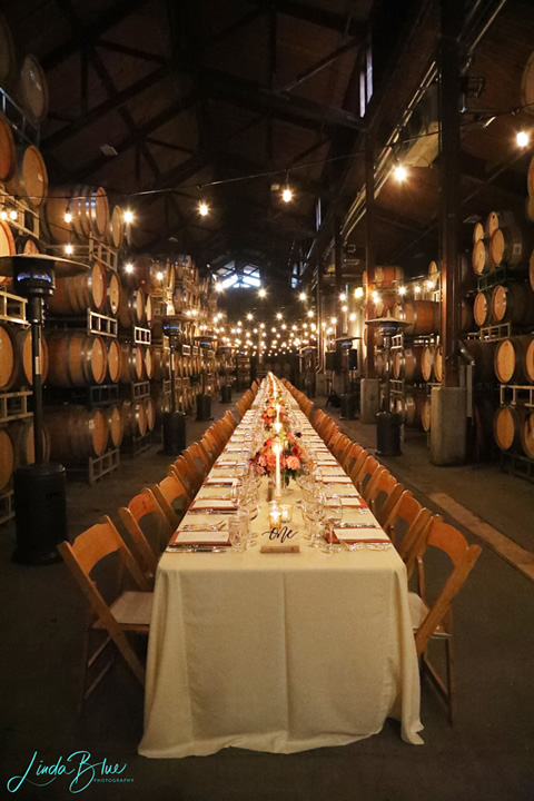 Long Table in Barrel Room with Settings and Centerpieces