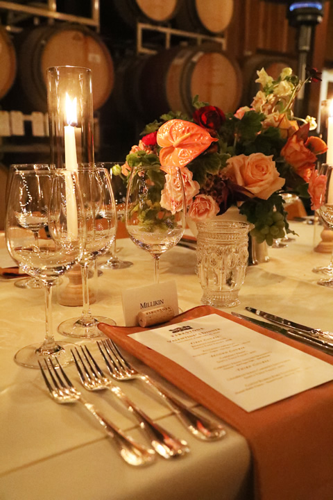 Table Setting with Candle, Flowers, and Wine Glasses