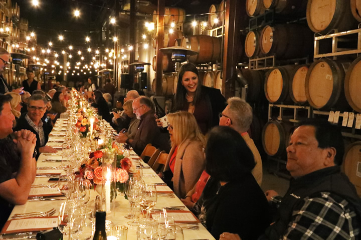 Large Table with Wine Being Poured