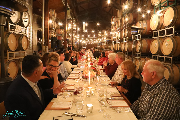 Long Table with Guests in Barrel Room