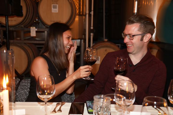 Two Lovebirds Laughing with Wine