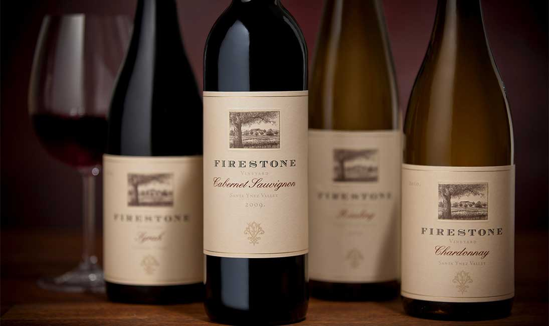 Four Bottles of Firestone Wines With Soft Focus and Glass of Wine on The Left