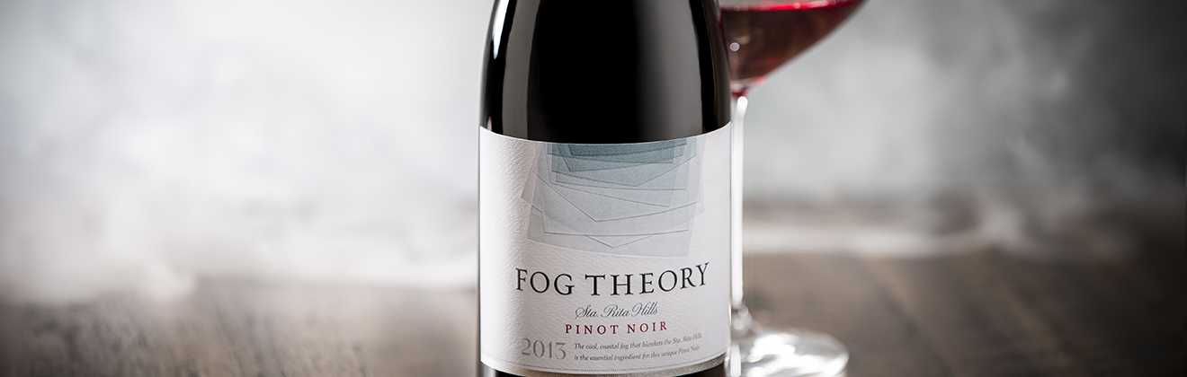 Bottle of Fog Theory With Wine Glass and Fog in Background
