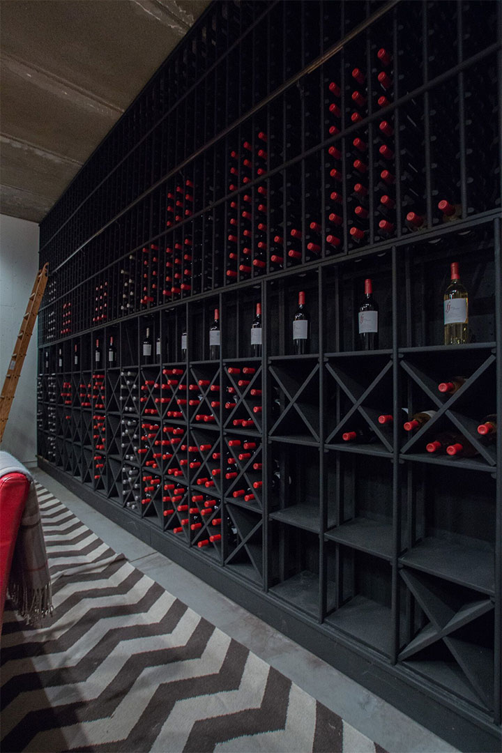 Full Wall Wine Rack Filled with Foley Johnson Wine