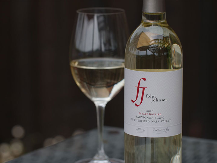 Bottle of Foley Johnson Sauvignon Blanc with Glass