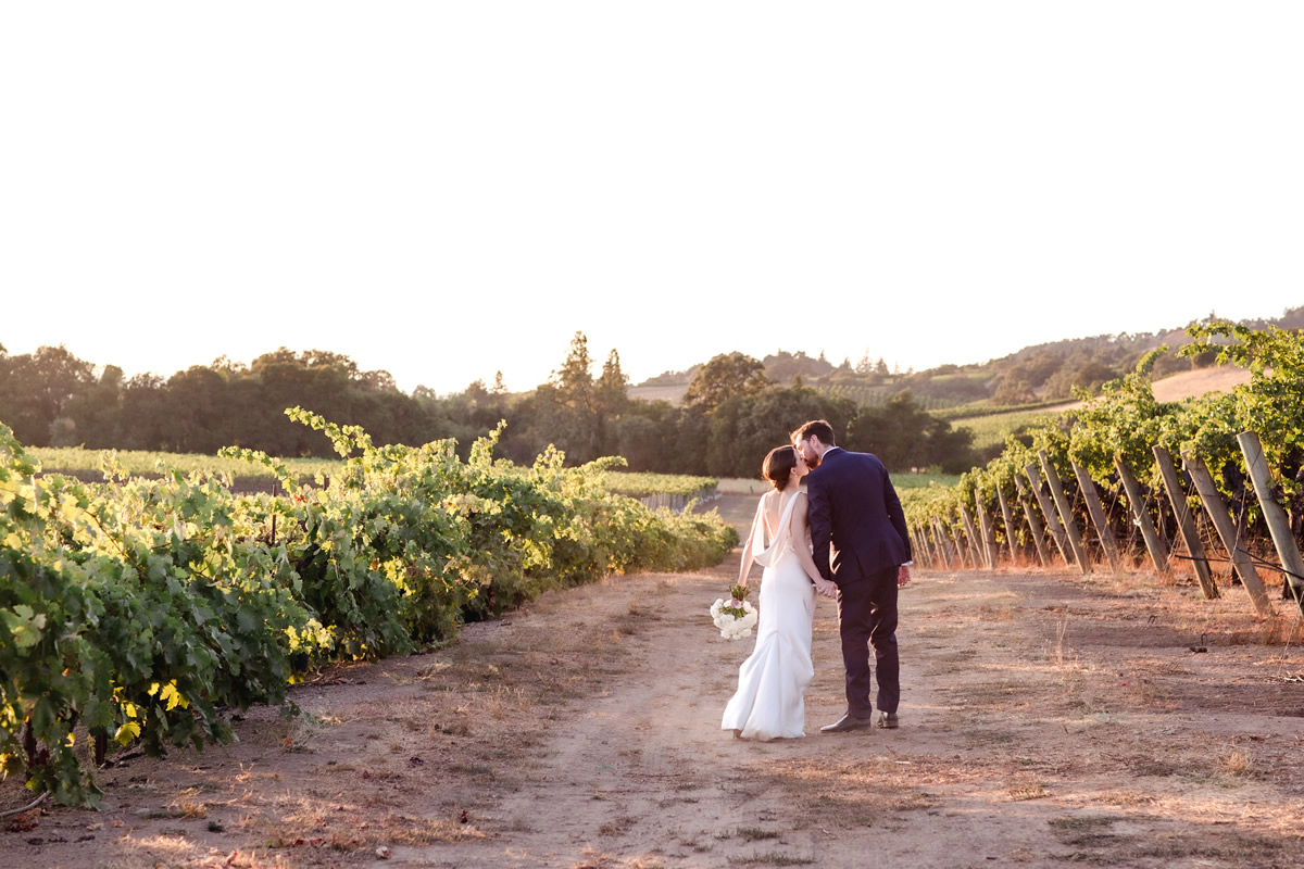 Bride & Groom Kissing in the Vineyards at Sunset