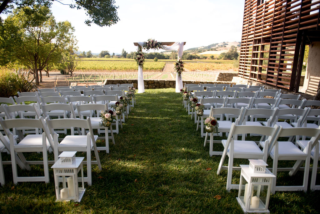 Outdoor Wedding with Flowers and Vineyard Views