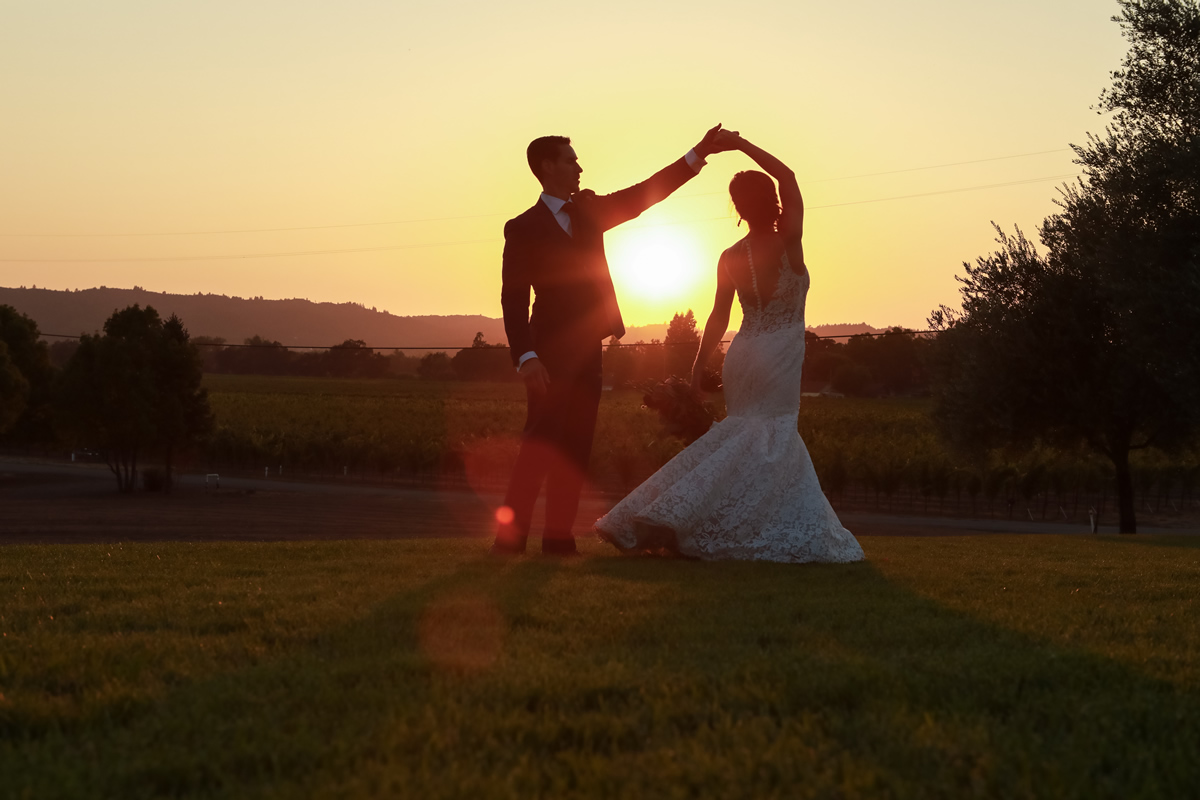 Wedding Couple Dancing on the Lawn in the Sunset