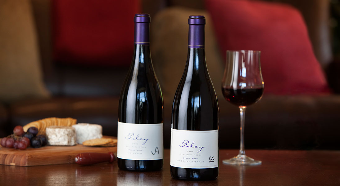 Two Bottles of Foley Wine With A Wine and Cheese Plate