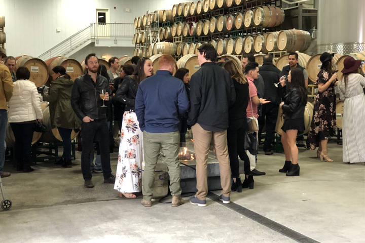 A group of Barrel Tasters enjoying the Roth Estate Barrel Room.