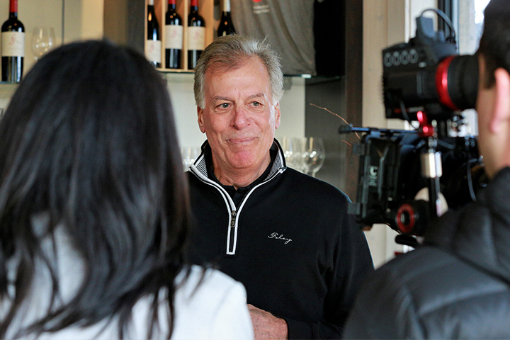 Bruce Cousins, COO of Foley Family Wines, speaking on camera about the PNV event.