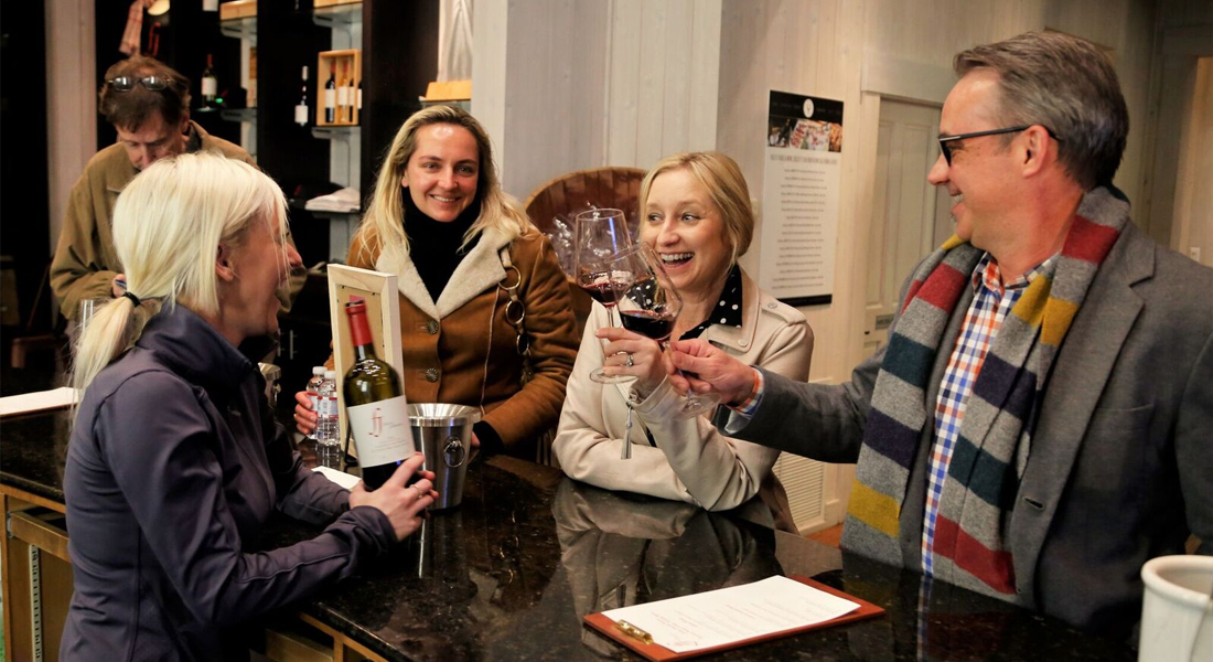 Wine tasters enjoying pours from a host at the Foley Johnson PNV Kickoff Party.