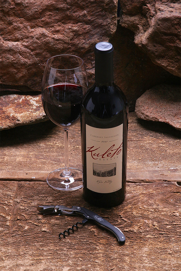 Bottle of Kuleto Red Wine with Glass