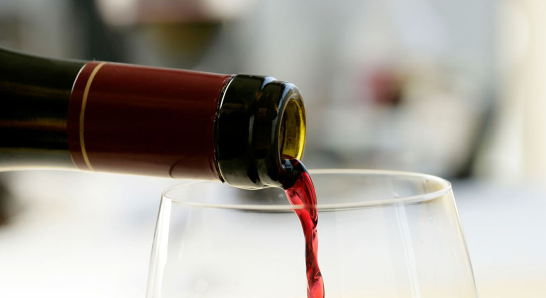 Wine flowing from bottle to glass