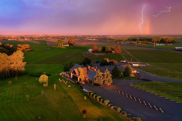 The Three Rivers Winery Exterior with Lightning and Rainbow
