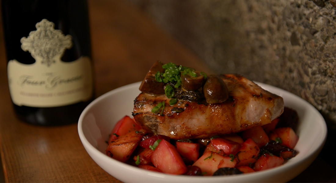 Pork served over red potatoes paired with Four Graces Pinot Noir