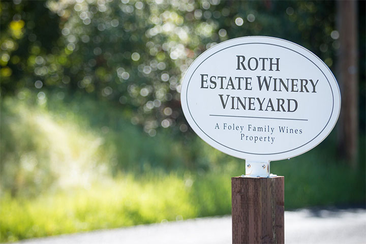 White Sign with Roth Estate Winery Vineyard Printed on It