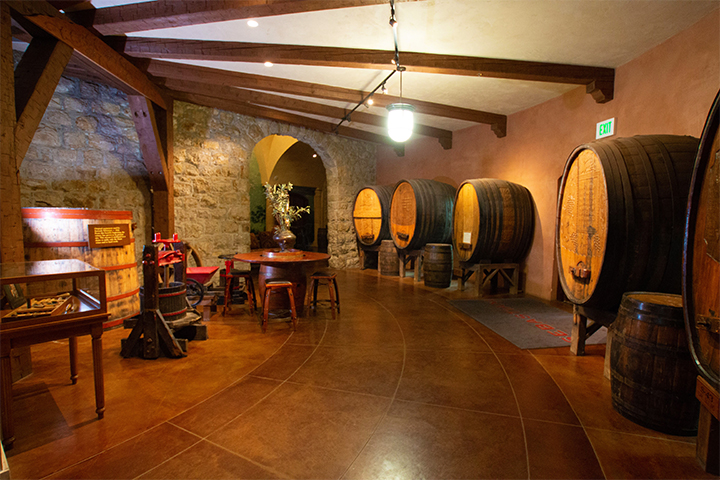 Barrel Room at Sebastiani with ornate wood carvings on old barrels