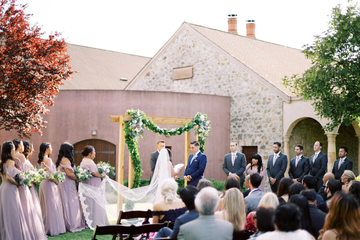 Bride and Groom Exchanging Vows in Sebastiani Rose Garden
