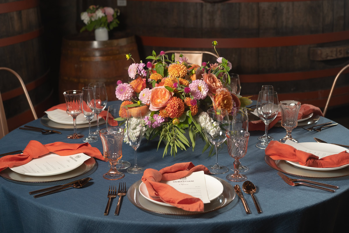 Wedding Dinner Table Setting with Floral Centerpiece