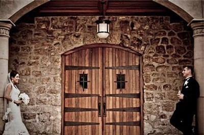 Bride and Groom On Each on Either Side of Large Wooden Doors of Sebastiani Winery