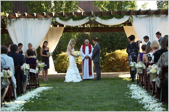 Bride and Groom Taking Wedding Vows in an Outdoor Ceremony