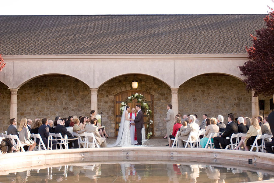 Bride and Groom Exchanging Wedding Vows in Front of Sebastiani Vineyards & Winery
