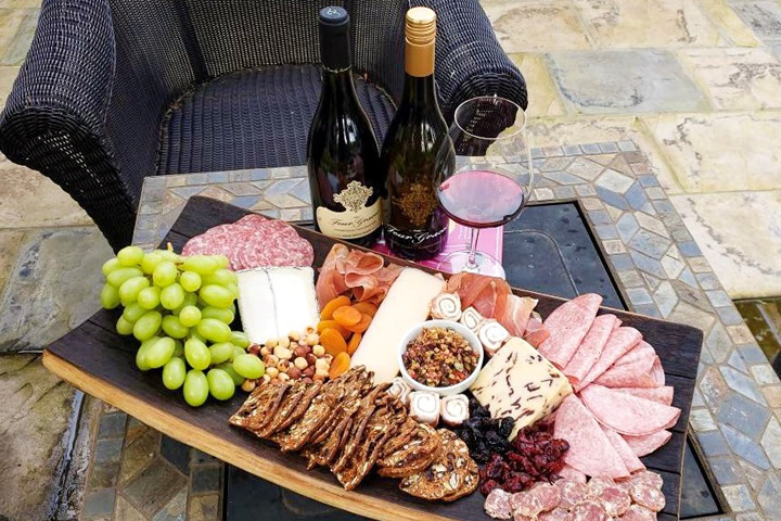 The Four Graces Charcuterie Board with 2 Bottles of Wine and Wine Glasses