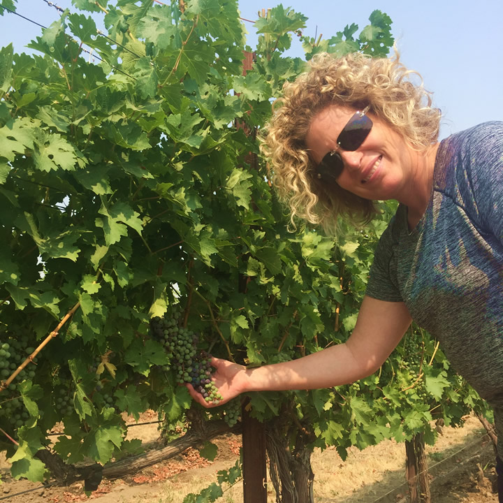 Winemaker Holly Turner Inspecting a Vineyard