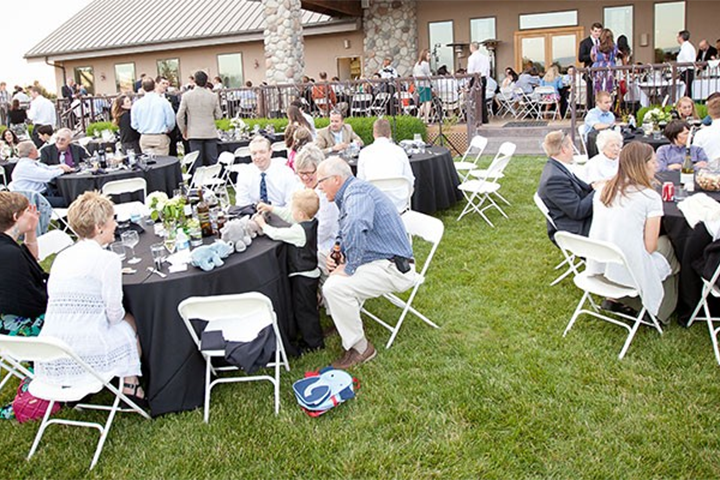 Round Tables Occupied By Guests at Three Rivers Winery