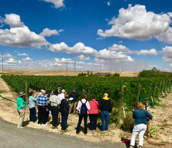 Guests Enjoying a Group Tour of Three Rivers Winery
